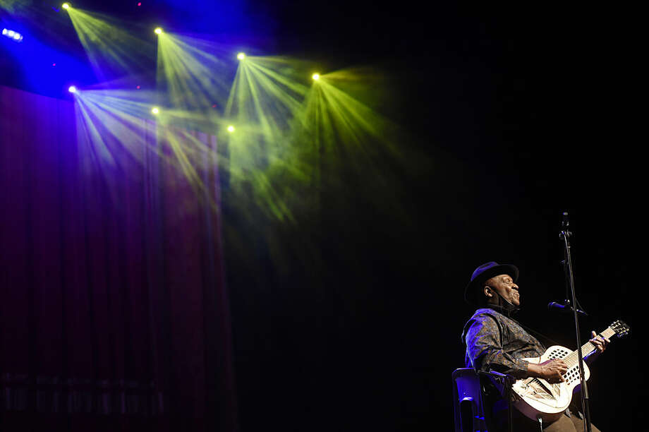 "Musician Taj Mahal performs onstage at the Eccles Theatre during the premiere of the four-part PBS music documentary series ""American Epic"" at the 2016 Sundance Film Festival on Thursday, Jan. 28, 2016, in Park City, Utah. (Photo by Chris Pizzello/Invision/AP)"