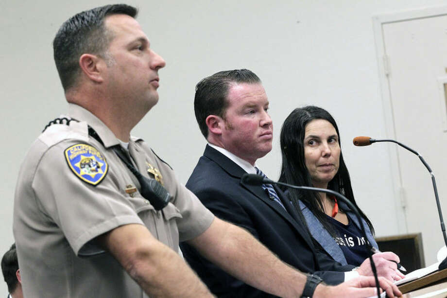 California Highway Patrol office Keith Odle, left, attorney William M. Concidine, center along with Cecilia Abadie, right, speak during a news conference, Thursday, Jan. 16, 2014 in San Diego. A San Diego traffic court threw out a citation Thursday against Abadie, a woman believed to be the first motorist in the country ticketed for driving while wearing a Google Glass computer-in-eyeglass device. (AP Photo/U-T San Diego, John Gastaldo, Pool)