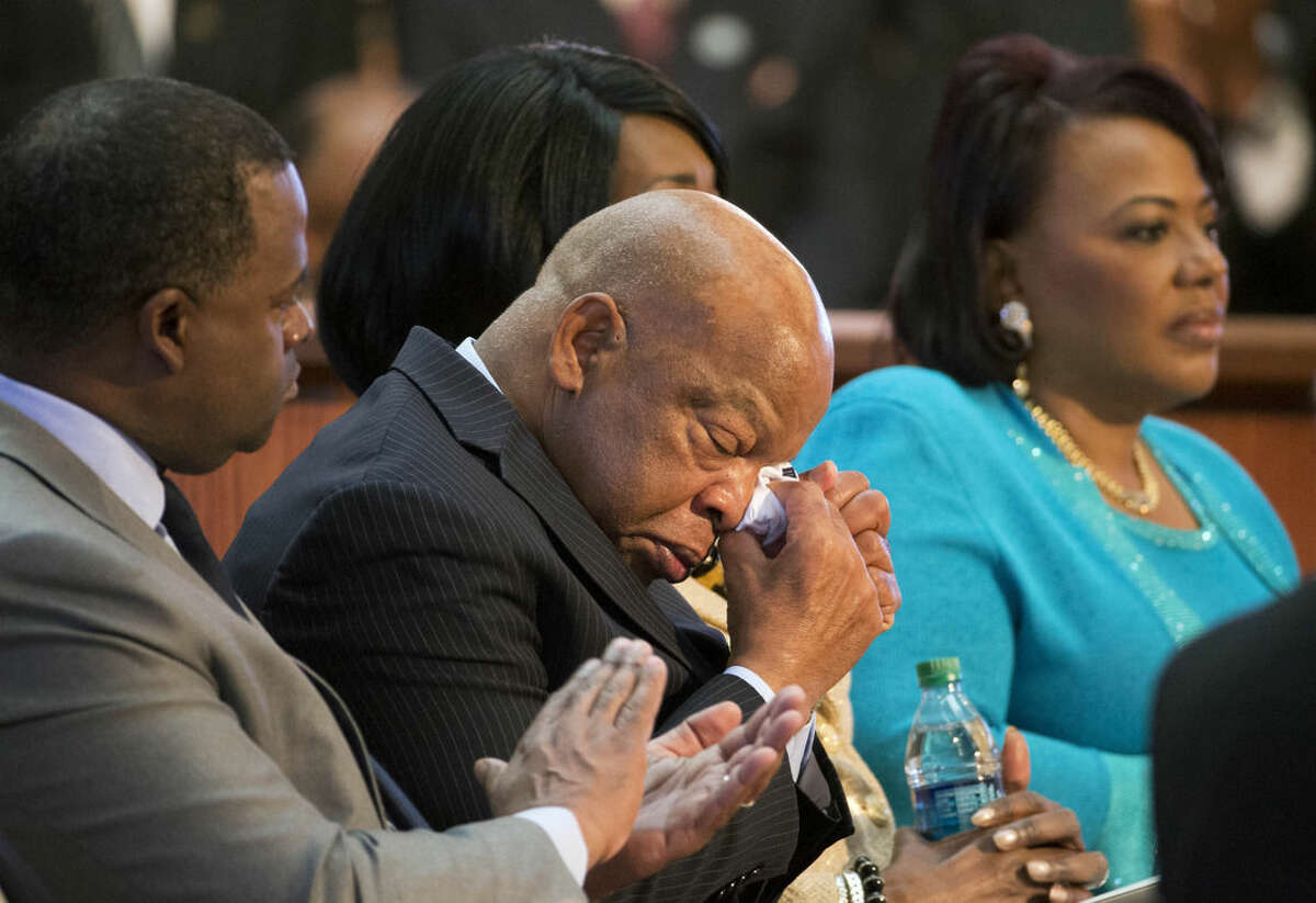 "U.S. Rep. John Lewis, D-Ga., center, wipes away a tear as actor David Oyelowo, who portrays the Rev. Martin Luther King Jr. in the movie ""Selma,"" speaks during a service honoring King at Ebenezer Baptist Church, where King preached, Monday, Jan. 19, 2015, in Atlanta. (AP Photo/David Goldman)"