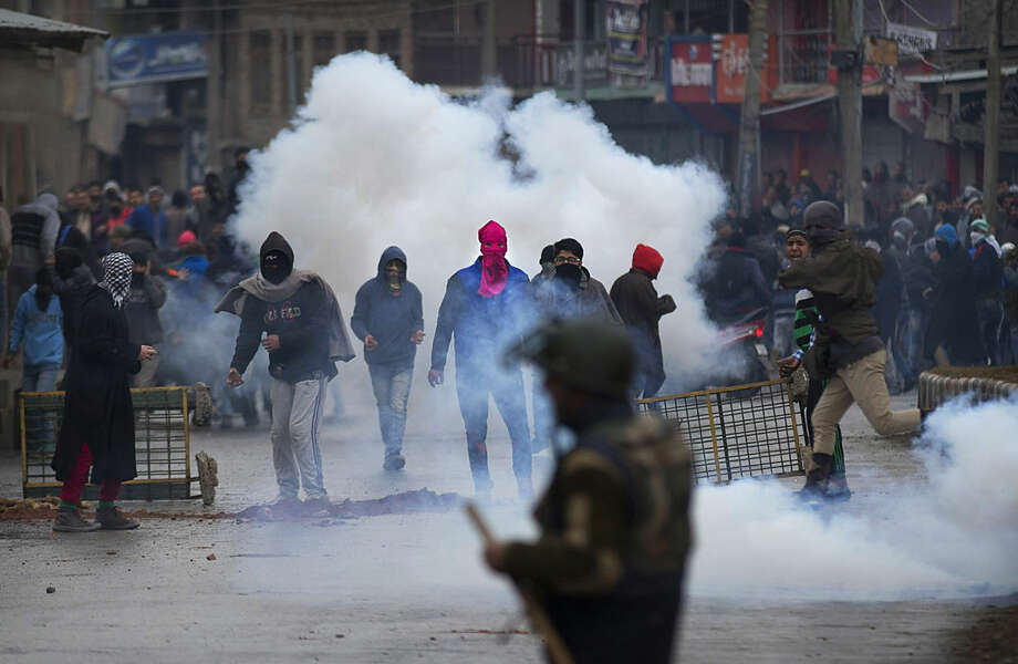 Kashmiri Muslim protesters hold bricks and stones to throw at Indian police and paramilitary soldiers during a protest in Srinagar, Indian controlled Kashmir, Friday, Jan. 29, 2016. Police fired teargas and rubber bullets to disperse Kashmiris who gathered after Friday afternoon prayers to protest against Indian control over a part of the disputed region. (AP Photo/Dar Yasin)