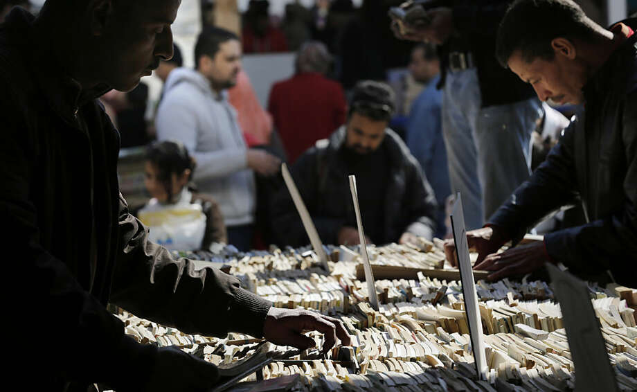 Egyptians brows second hand books at the 47th aannual Cairo International Book Fair, Friday, Jan. 29, 2016. (AP Photo/Amr Nabil)