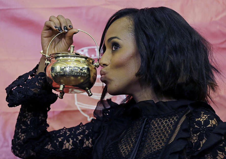 Actress Kerry Washington, Harvard University's Hasty Pudding Theatricals' Woman of the Year, poses with the pudding pot, Thursday, Jan. 28, 2016, in Cambridge, Mass. (AP Photo/Elise Amendola)