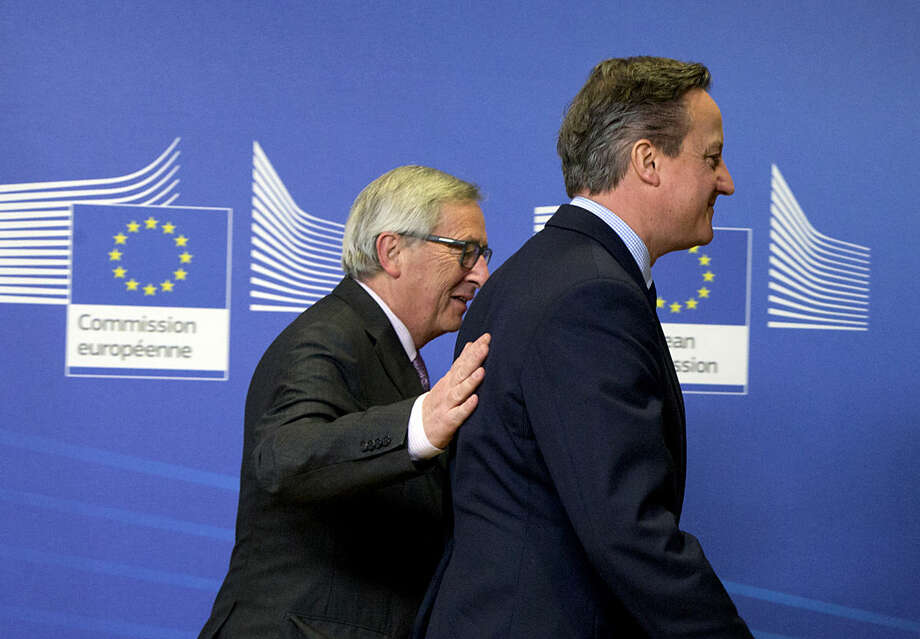 British Prime Minister David Cameron, right, walks with European Commission President Jean-Claude Juncker prior to a meeting at EU headquarters in Brussels on Friday, Jan. 29, 2016. British Prime Minister David Cameron is kicking off a high-stakes weekend of diplomatic negotiations on the European Union reforms with a visit to EU headquarters. (AP Photo/Virginia Mayo)