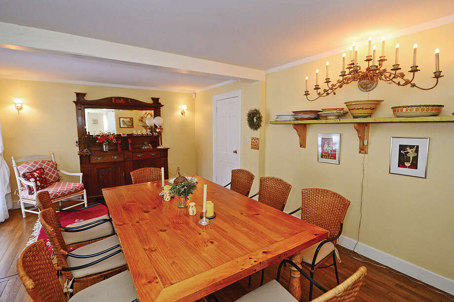 Hour photo / Erik Trautmann The dining room in the Sturges House. The house at 228 Wolfpit Ave in Norwalk was built in the early 19th century and is currently on the market with William Pitt Realty.