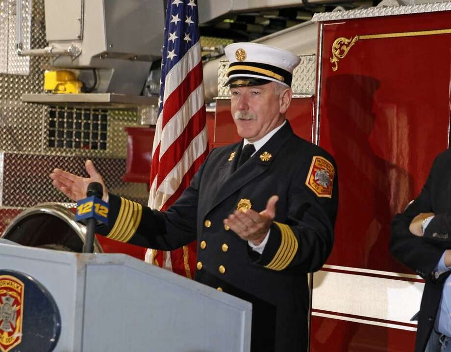 Fire Chief Denis McCarthy prepares to swear in 4 new Firefighters Friday morning at the temporary Fire Hedquarters on Fairfield Avenue in Norwalk. Hour Photo / Danielle Robinson