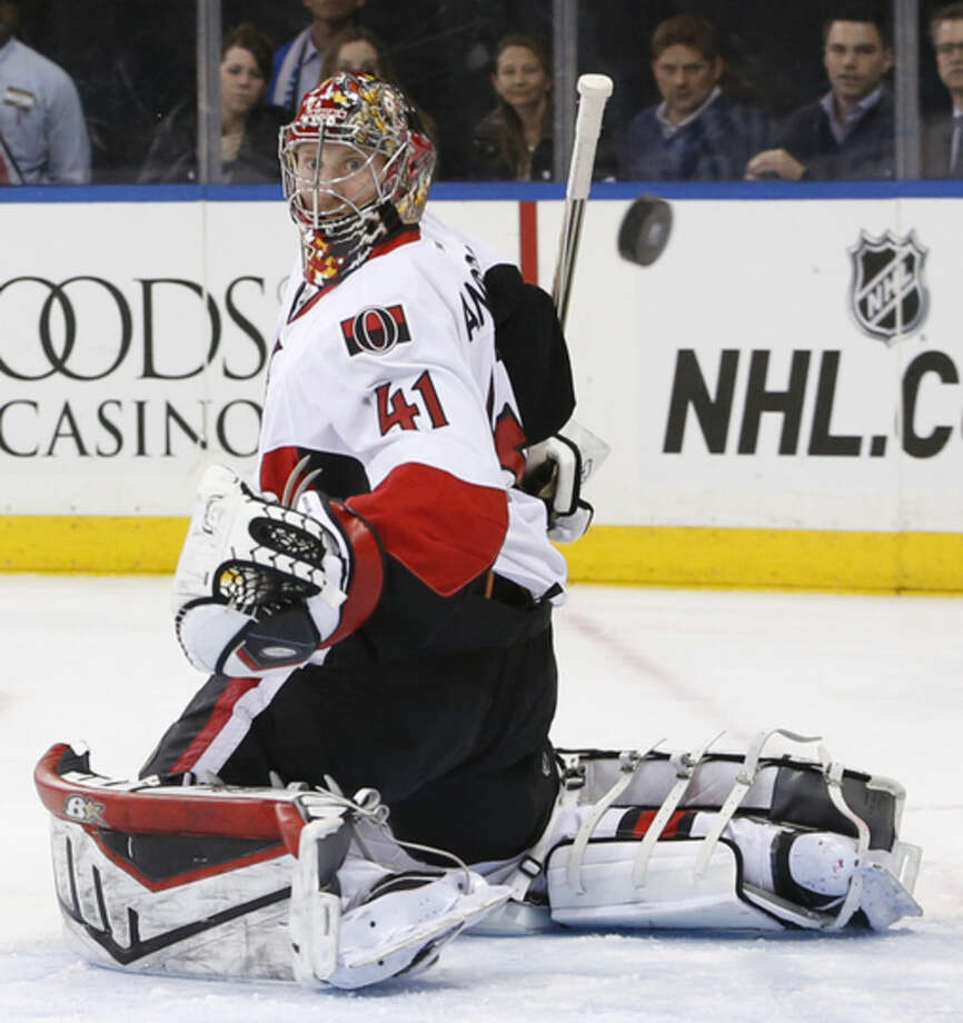 Ottawa Senators goalie Craig Anderson keeps his eyes on the puck as it sails by him during the second period of an NHL hockey game against the New York Rangers at Madison Square Garden in New York, Tuesday, Jan. 20, 2015. (AP Photo/Kathy Willens)