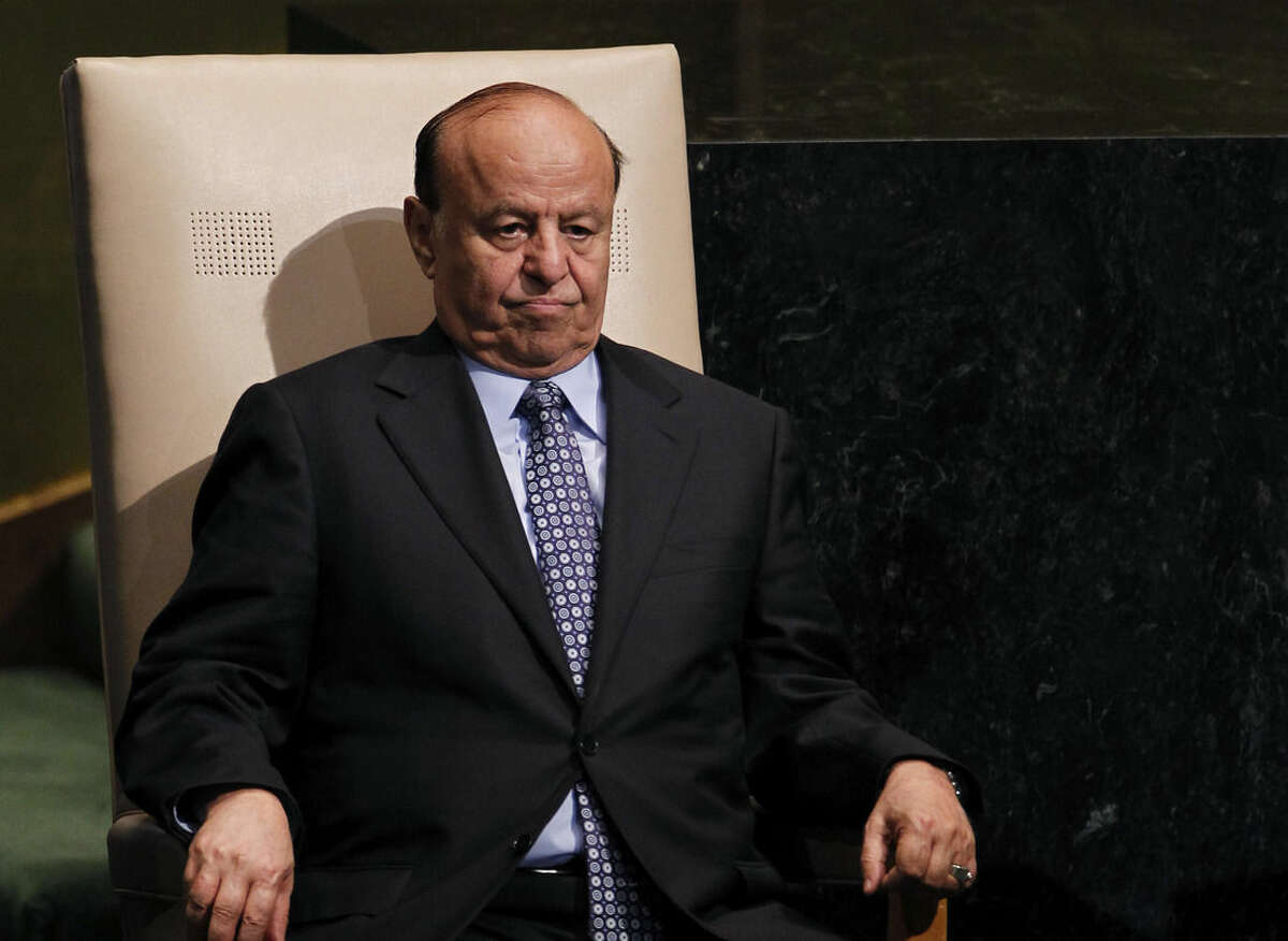 FILE - In this Wednesday, Sept. 26, 2012 file photo, Abed Rabbo Mansour Hadi, President of Yemen, sits after addressing the 67th session of the United Nations General Assembly at U.N. headquarters. Two of the Yemeni embattled president's advisers said that the president is held
