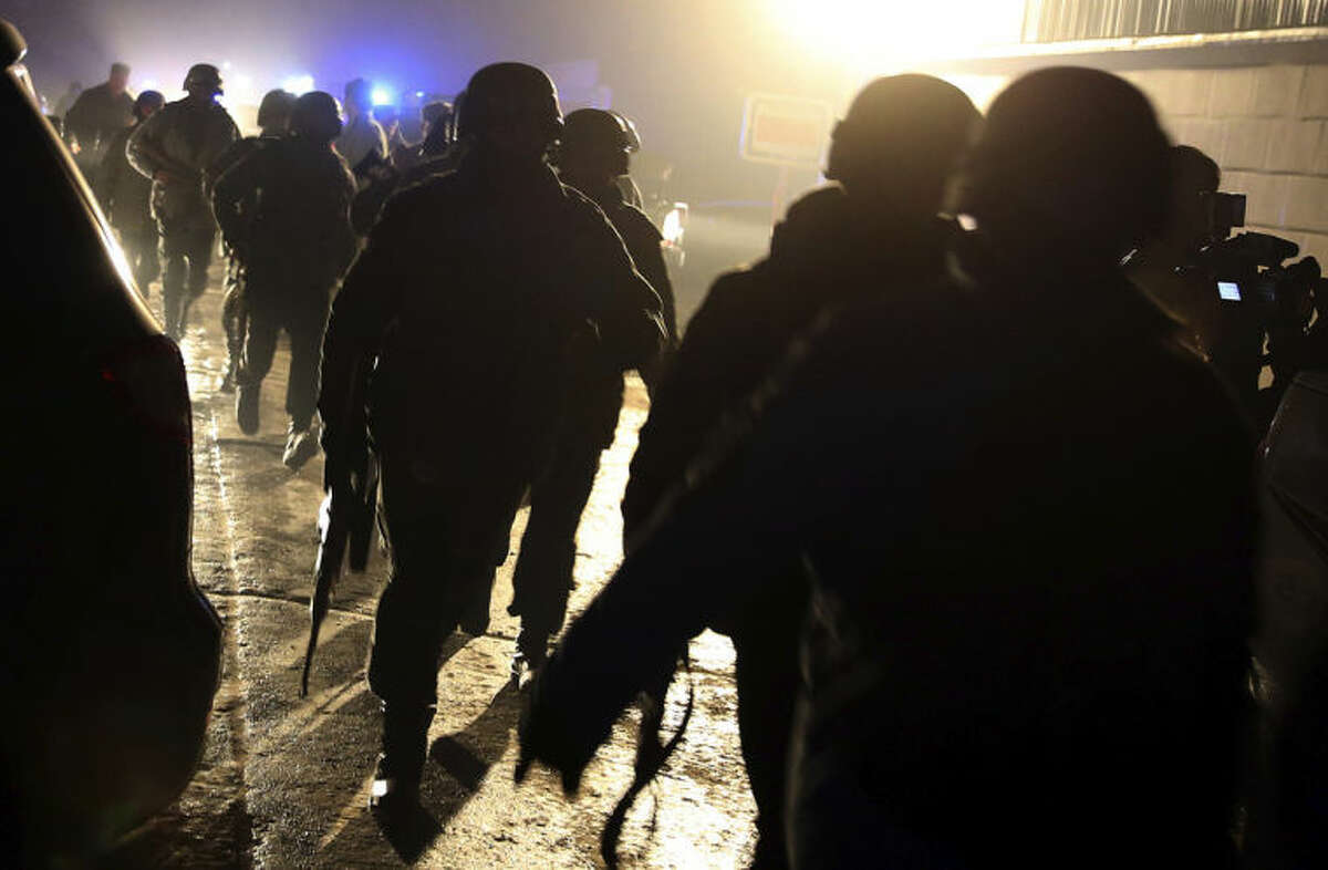 Afghan security forces arrive at the site of a suicide attack in Kabul, Afghanistan, Friday, Jan. 17, 2014. Afghan police say a suicide bomber has attacked a restaurant in central Kabul that is popular with officials, foreigners and business people. There were reports of casualties. (AP Photo/Massoud Hossaini)