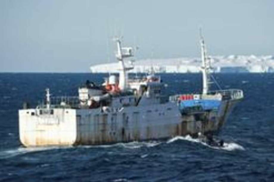 "This Jan. 14, 2015 photo provided by the Royal New Zealand Navy shows the illegal fishing boat, the ""Songhua"" in the Southern Ocean off the coast of New Zealand. In 2008, when the Songhua was named the Paloma V, an investigation linked that ship to a Spanish company, Vidal Armadores. In 2010, the company was fined 150,000 euros for participating in illegal fishing activities with the Paloma V near Antarctica. (AP Photo/ Royal New Zealand Navy)"