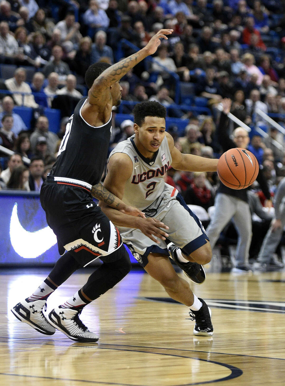 Connecticut's Jalen Adams (2) during the first half of an NCAA college basketball game in Hartford, Conn., on Thursday, Jan. 28, 2016. (AP Photo/Fred Beckham)
