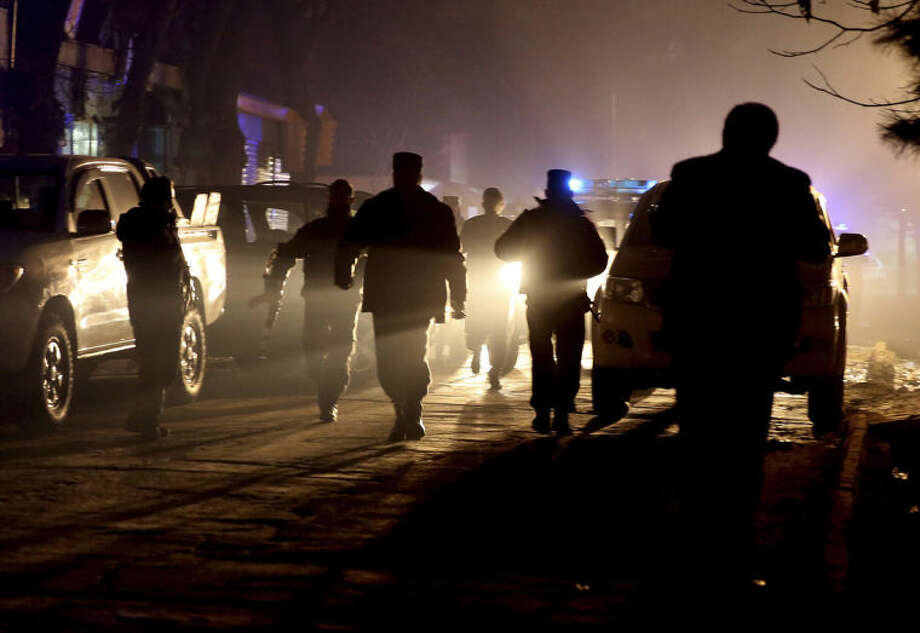 Afghan security forces arrive at the site of an explosion in Kabul, Afghanistan, Friday, Jan. 17, 2014. Afghan police said a suicide bomber attacked a Kabul restaurant popular with foreigners, officials.(AP Photo/Massoud Hossaini)