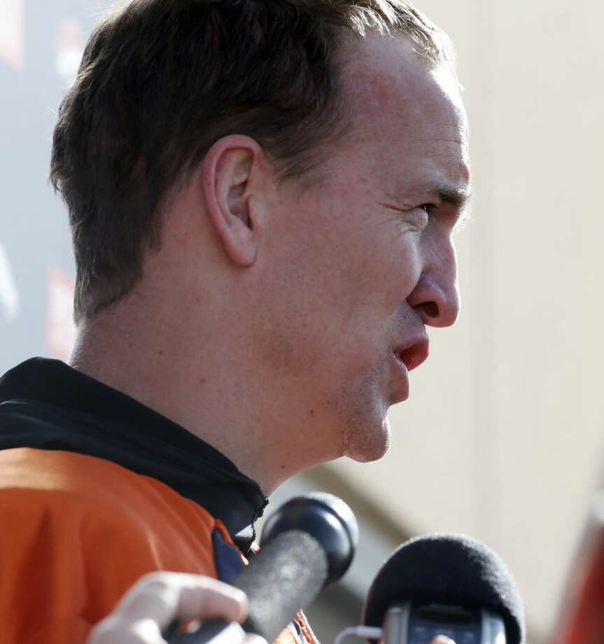 Denver Broncos quarterback Peyton Manning speaks at a news conference after NLF football practice in Englewood, Colo., on Thursday, Jan. 16, 2014. The Broncos are scheduled to host the New England Patriots on Sunday for the AFC championship. (AP Photo/Ed Andrieski)