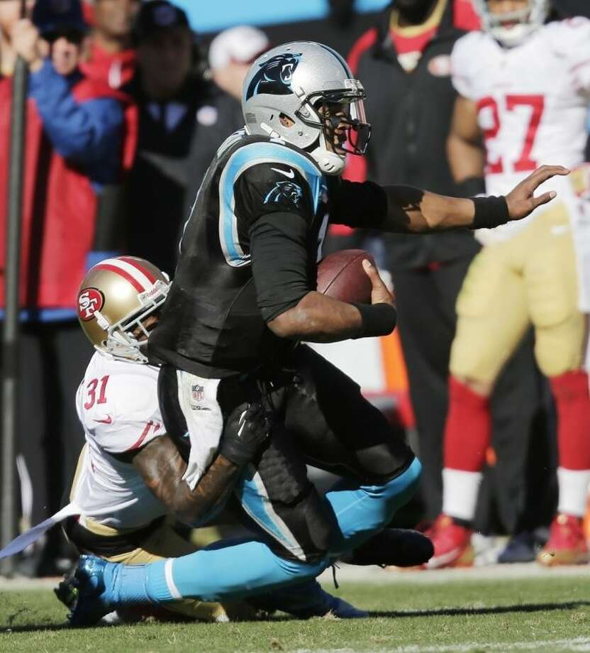 San Francisco 49ers strong safety Donte Whitner (31) tackles Carolina Panthers quarterback Cam Newton (1) during the first half of a divisional playoff NFL football game, Sunday, Jan. 12, 2014, in Charlotte, N.C. (AP Photo/Chuck Burton)
