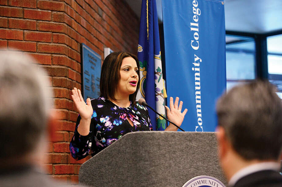Hour photo / Erik Trautmann Officials including Connecticut Association for Human Services Chief Program Officer, Maribel Santana, announce the kick-off of the annual Volunteer Income Tax Assistance program Friday in the East Campus Atrium of Norwalk Community College.