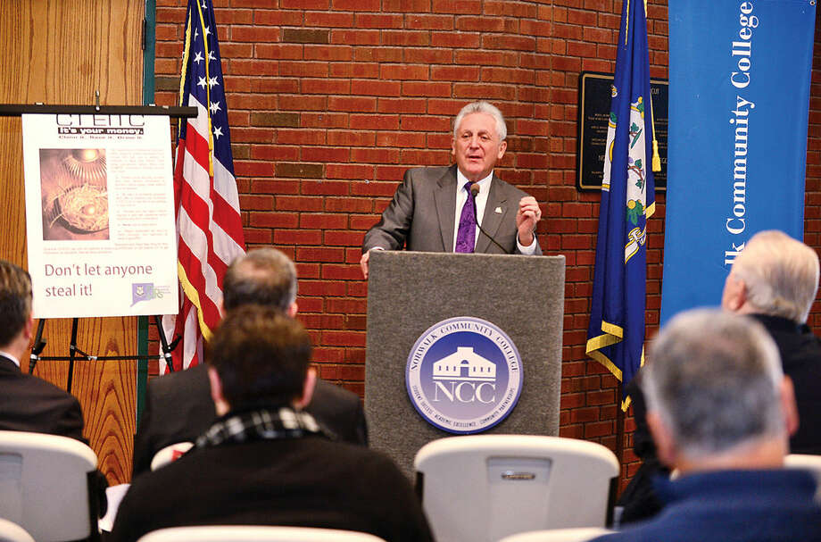Hour photo / Erik Trautmann Officials including Norwalk Mayor Harry Rilling announce the kick-off of the annual Volunteer Income Tax Assistance program Friday in the East Campus Atrium of Norwalk Community College.