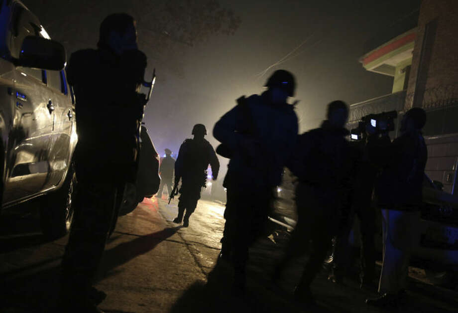 Afghan security forces arrive at the site of an explosion in Kabul, Afghanistan, Friday, Jan. 17, 2014. Afghan police said a suicide bomber attacked a Kabul restaurant popular with foreigners, officials. (AP Photo/Massoud Hossaini)