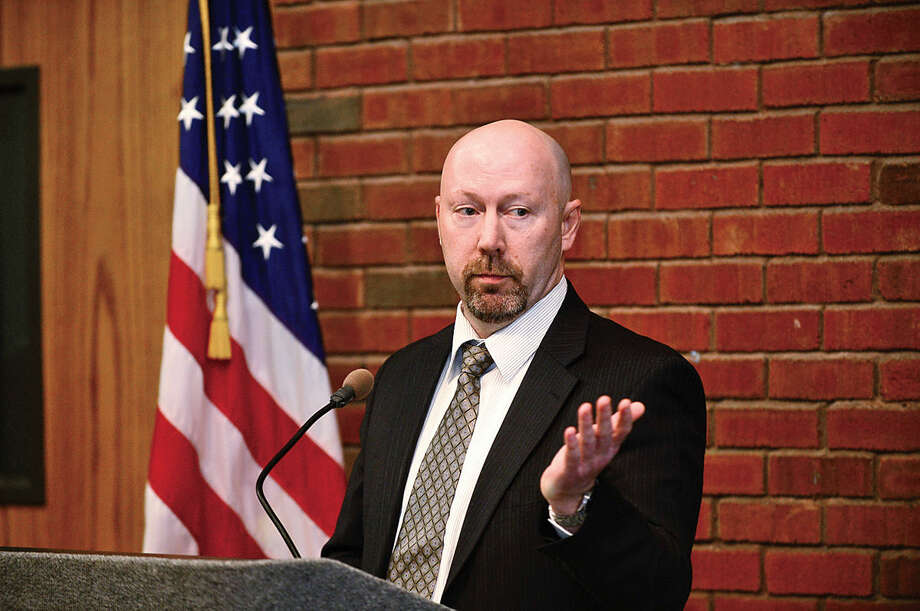 Hour photo / Erik Trautmann Officials including CT Department of Revenue Services Corrections Examiner, Jamie Finely, announce the kick-off of annual Volunteer Income Tax Assistance program Friday in the East Campus Atrium of Norwalk Community College.