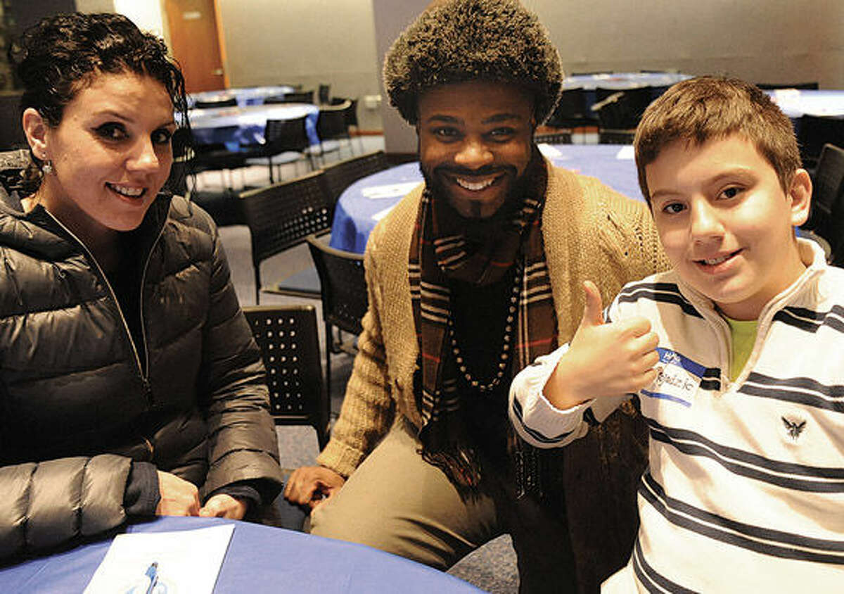 James Laramee, center, is a mentor to Dolan Middle School student Semir Bojadzic, who sits with his mother, Mersiha, Tuesday at the Mentor Appreciation Night held at UConn-Stamford.