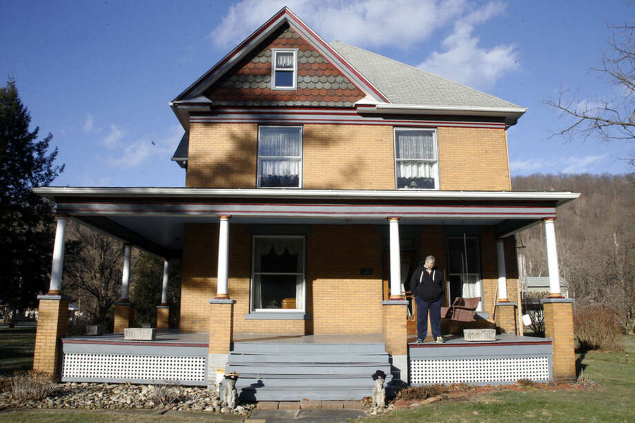 "FILE - In this Jan. 11, 2016 file photo, Scott Lloyd stands on the front porch of his home which is the house used as the home of psychotic killer Buffalo Bill in the 1991 film ""The Silence of the Lambs"" in Perryopolis, Pa. An animal rights group wants to convert the western Pennsylvania house into an empathy museum, where visitors could wear the skins of slain and abused animals. The group People for the Ethical Treatment of Animals says in a release that it's written to the real estate agent handling the sale and wants to turn it into a museum. (AP Photo/Keith Srakocic)"