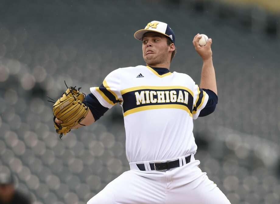 Michigan starting pitcher Brett Adcock (35) delivers against Maryland during the fourth inning of the NCAA Big Ten tournament championship college baseball game Sunday, May 24, 2015, in Minneapolis. Michigan won 4-3. (AP Photo/Hannah Foslien) Photo: Hannah Foslien/AP