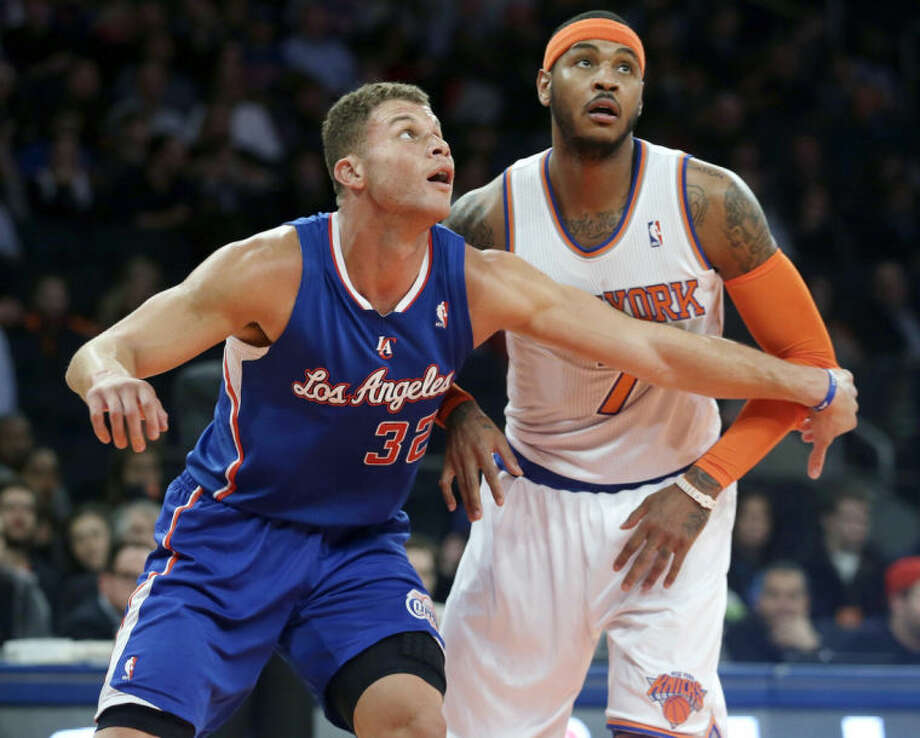 New York Knicks' Carmelo Anthony, right, and Los Angeles Clippers' Blake Griffin (32) fight for position during the first half of an NBA basketball game, Friday, Jan. 17, 2014, in New York. (AP Photo/Frank Franklin II)