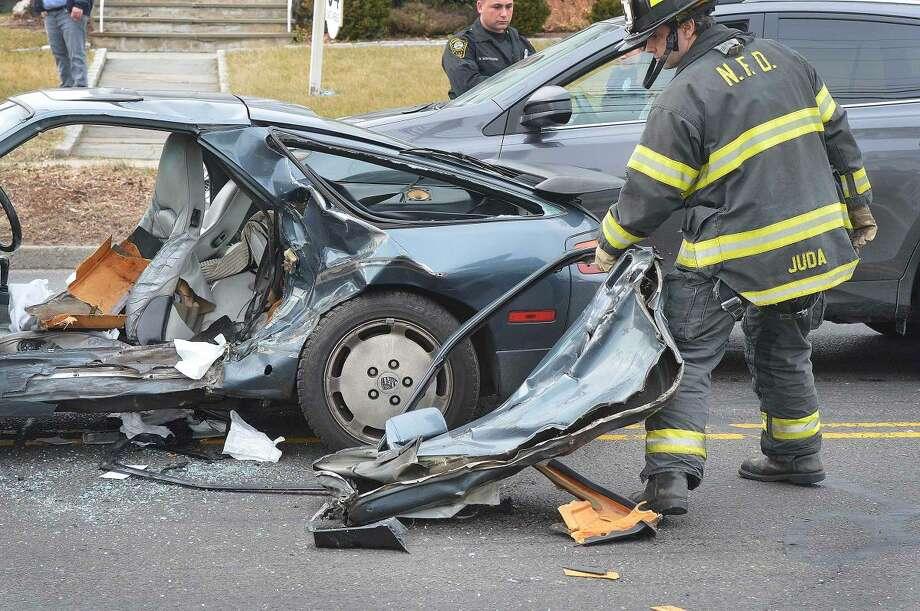 Hour Photo/Alex von Kleydorff Norwalk Firefighters clear the scene of a multi vehicle accident on East Ave so traffic can begin to move.