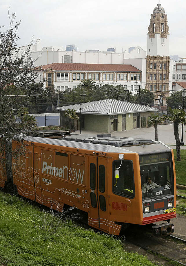 A San Francisco MUNI streetcar train rides past a public restroom facility, center, at Dolores Park in San Francisco, Thursday, Jan. 28, 2016. The popular San Francisco park this week has reopened with renovations and the new public urinal, the latest move to combat public urination in the city. (AP Photo/Jeff Chiu)