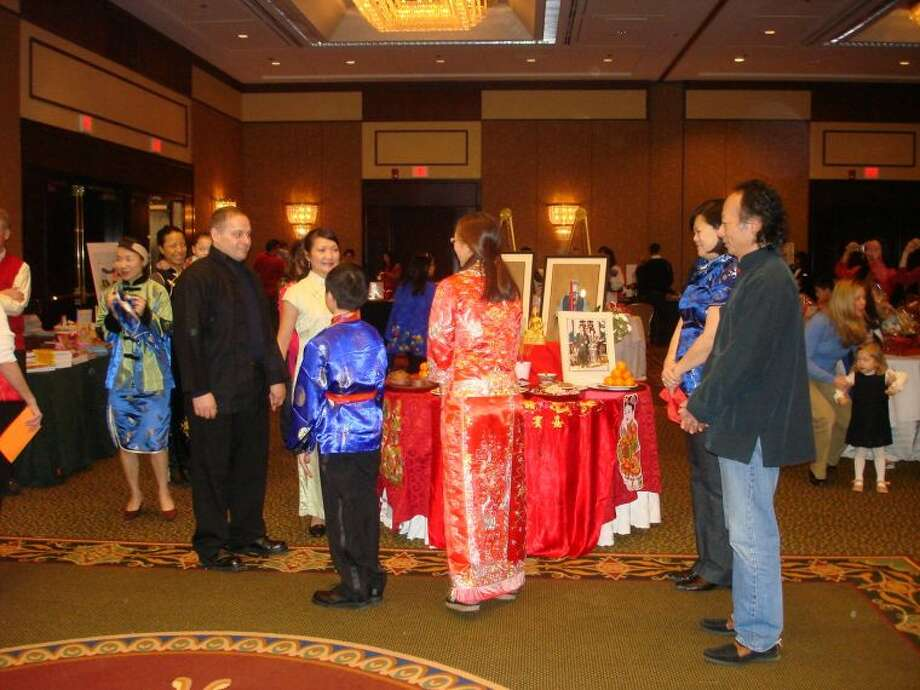 There are surprises each year at Chinese Language School of Connecticut's annual Chinese New Year celebration. This year, it will be at the Stamford Hilton. In past years, CLSC hosted a wedding, ancestral alter or a bamboo forest. Photo is from a past New Year event depicting a wedding ceremony.
