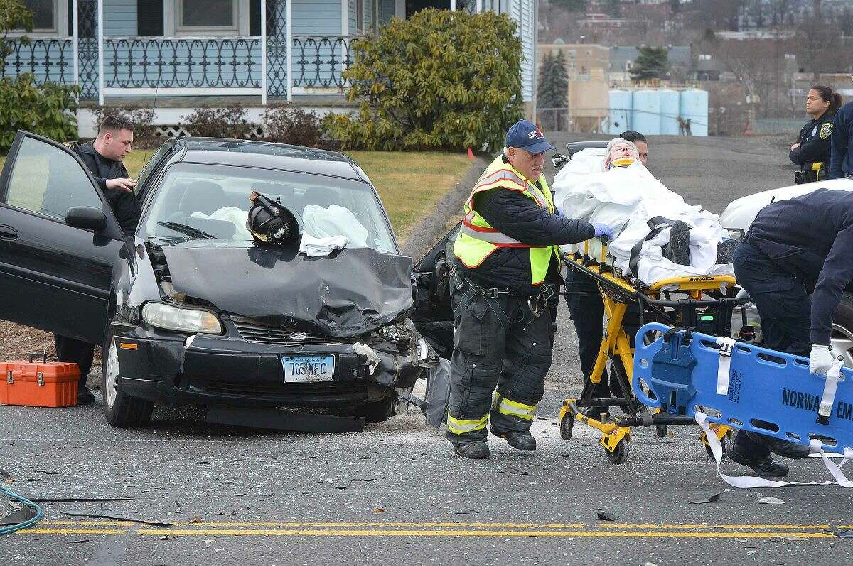 Hour Photo/Alex von Kleydorff Norwalk emergency personel respond to a multi vehicle accident at 96 East Ave on Wednesday afternoon, the drivers of both cars had to be extricated by the Norwalk Fire Departmentand were transported to Norwalk Hospital