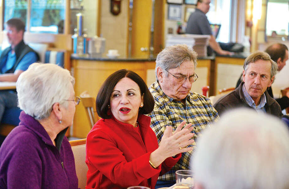 "State Sen. Toni Boucher, second from left, speaks during a ""Coffee Hours"" public discussion state Reps. Gail Lavielle and Tom O'Dea at Orem's Diner in Wilton Tuesday morning."