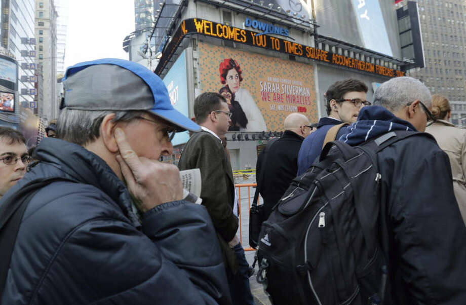 In this Dec. 4, 2013 photo, a man puts his fingers in his ears in New York's Times Square. Noise is New York City's biggest quality of life complaint. In 2013, the city's 311 hotline got more than 260,000 calls about excessive noise, up 30 percent in two years. (AP Photo/Richard Drew)