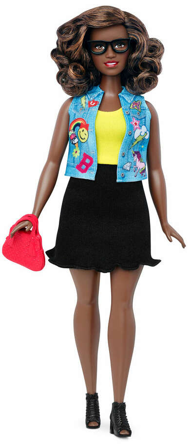 This photo provided by Mattel shows a new, curvy Barbie Fashionista doll introduced in January 2016. Mattel, the maker of the famous plastic doll, said it will start selling Barbie's in three new body types: tall, curvy and petite. She'll also come in seven skin tones, 22 eye colors and 24 hairstyles. (Mattel via AP)