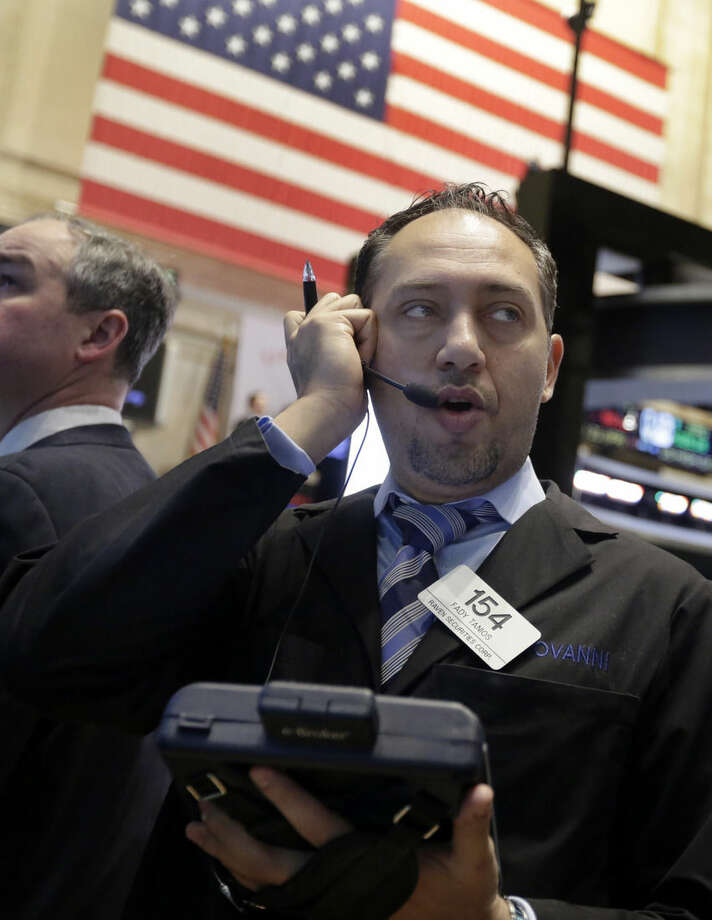 Trader Fady Tanios works on the floor of the New York Stock Exchange Wednesday, Jan. 21, 2015. The U.S. stock market is mixed in early trading after two straight days of gains. (AP Photo/Richard Drew)
