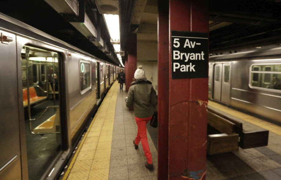 In this Dec. 4, 2013 photo, two #7 New York City subway trains arrive in the 5th Avenue-Bryant Park station, in New York. Roaring electric motors, squealing breaks, whistles and bells can fill a subway tunnel as trains pull into the station. Plenty of places in the city has noise that tops 85 decibels, a level that can cause hearing damage with prolonged exposure. (AP Photo/Richard Drew)