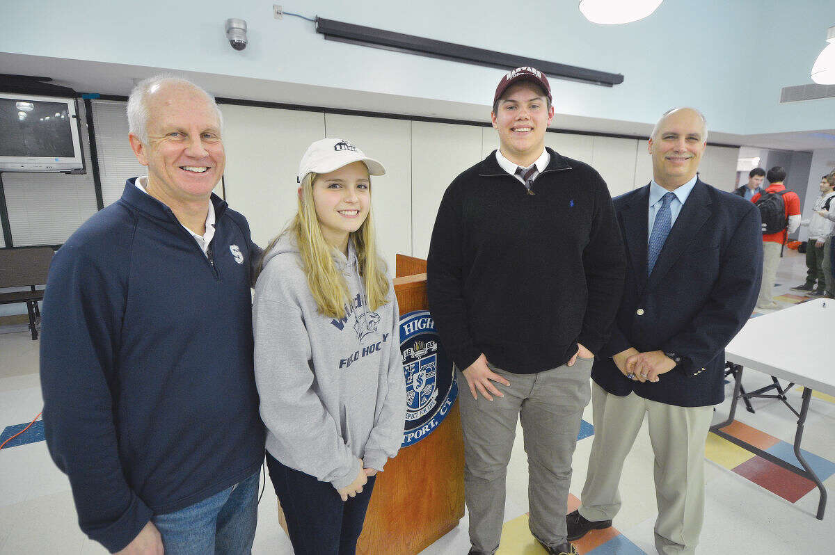 Hour Photo/Alex von Kleydorff Coach Ian Tapsall and Jordan Ragland with Jackson Ward and Coach Marce Petroccio, after signing letters of intent to UNH and Harvard respectively.