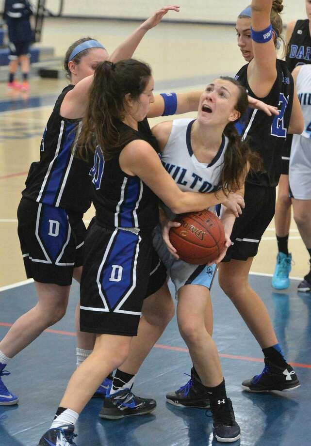 Hour Photo/Alex von Kleydorff. Wiltons #24 Caylin Cannavino trys to get a shot vs Darien