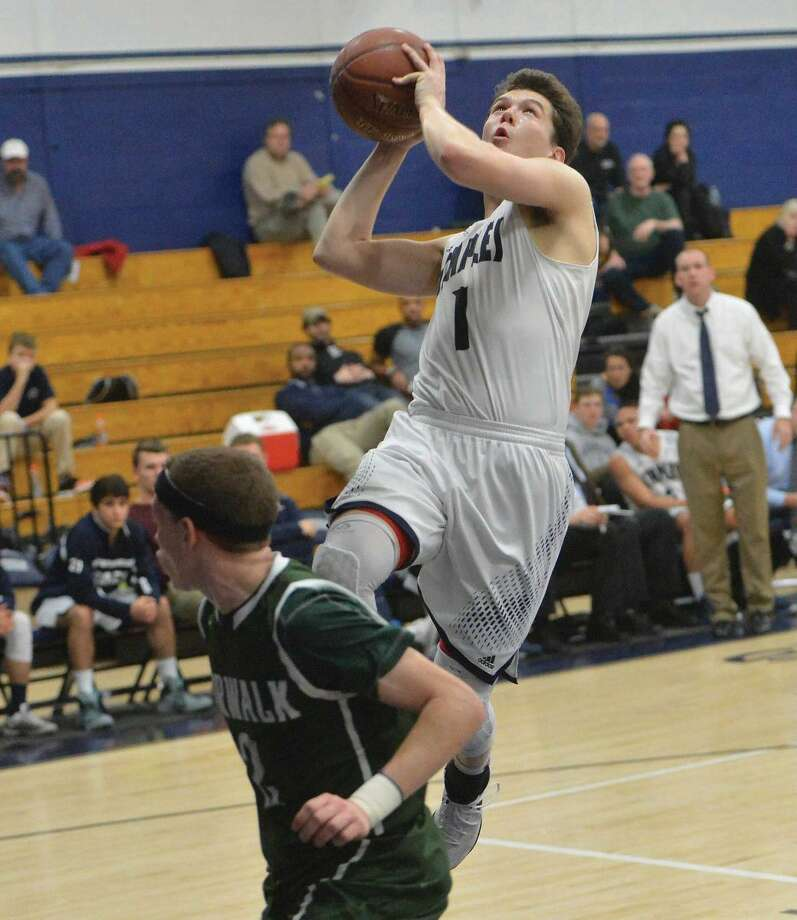 Hour Photo/Alex von Kleydorff. Staples #1 Justin Seidman shoots and scores vs Norwalk