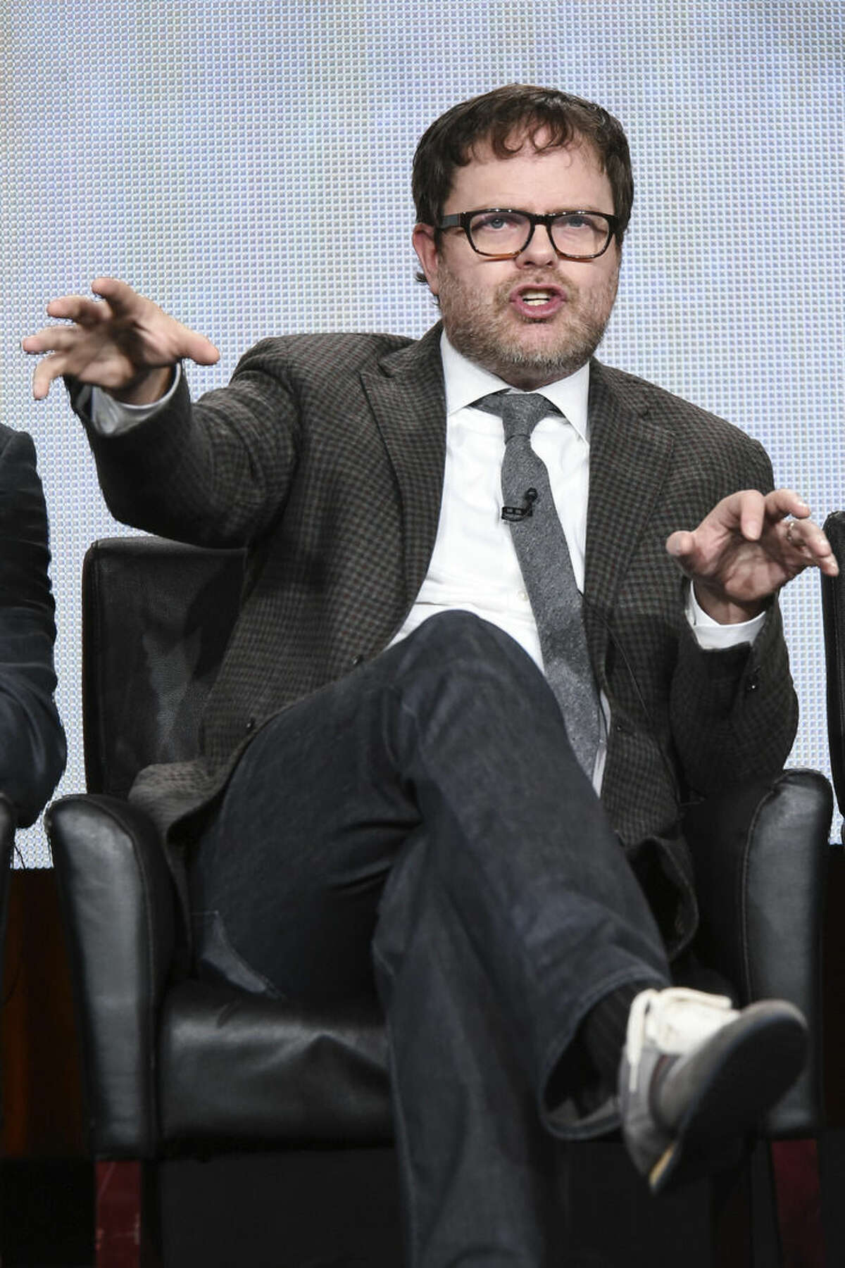 """Rainn Wilson speaks on stage during the """"Backstrom"""" panel at the Fox 2015 Winter TCA on Saturday Jan. 17, 2015, in Pasadena, Calif. (Photo by Richard Shotwell/Invision/AP)"""