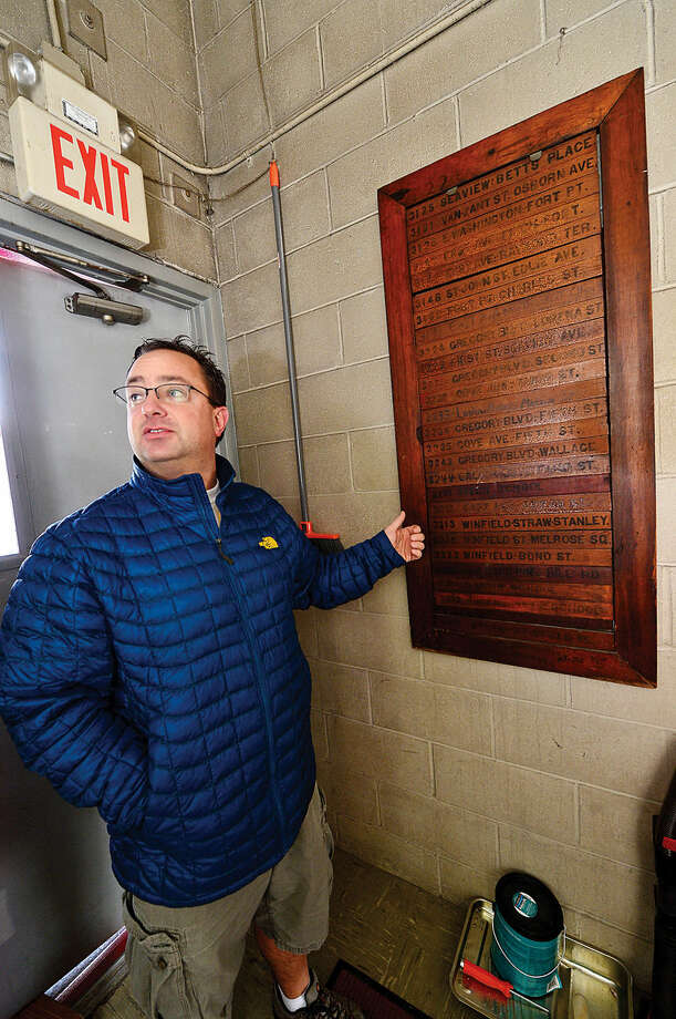 Hour photo / Erik Trautmann Norwalk Fire Captain Jonathan Maggio points out the old call box during a tour of Fire Station 3. Station 3 is the oldest fire station in the city, built for the Mayflower Hook and Ladder Volunteer Company in the 1890's, and is undergoing extensive restorative effort led by the firefighters who work there.