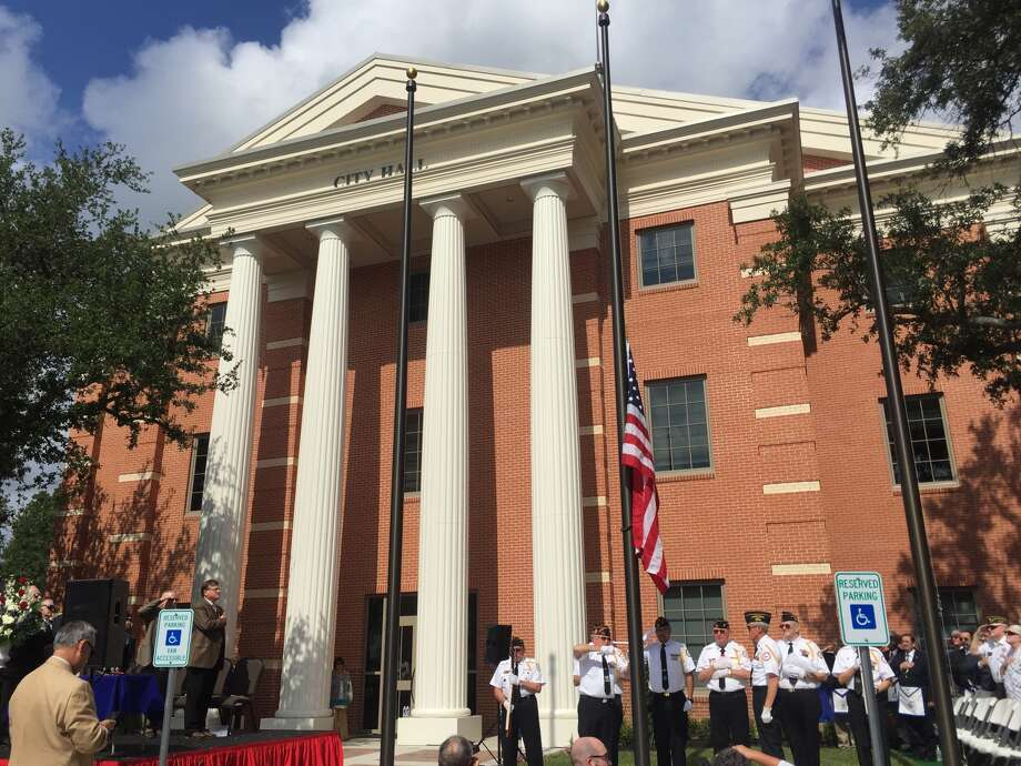 The United States flag is raised Friday, June 10, 2016, at the dedication of the new Katy City Hall. Photo: Emily Foxhall