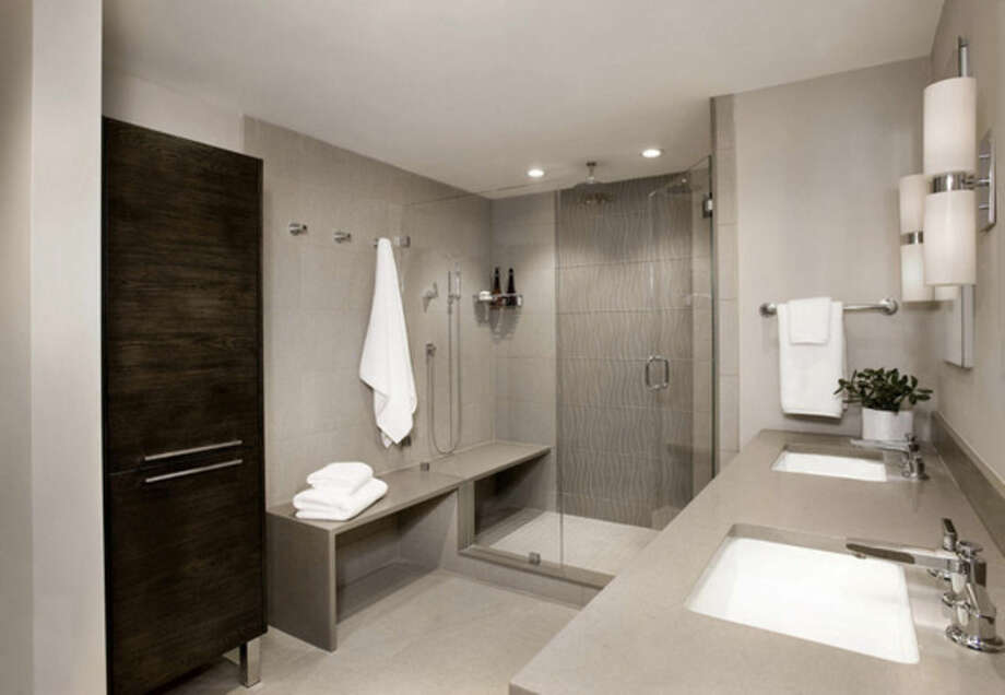 Photo by Shelly HarrisonThis sleek, neutral bathroom was co-designed by Jaye Gordon and Mark Haddad of Haddad Hakansson Design Studio in Belmont, Mass. The shower features a hand-held shower head, body sprays and main shower head as well as a rainshower head.