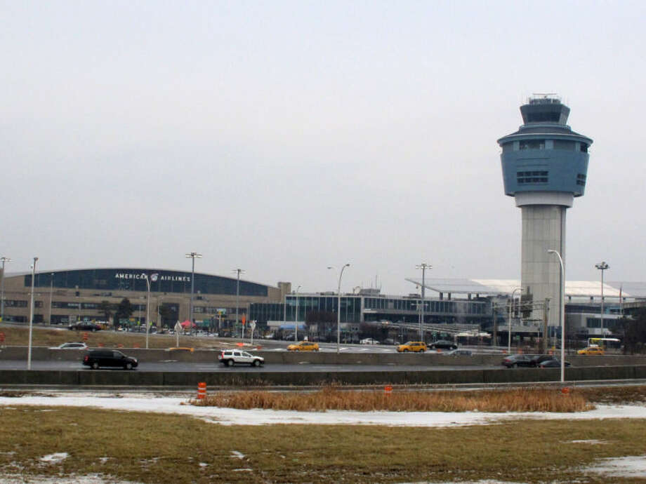 In this Jan. 10, 2014, photo, the control tower and hangars at New York's LaGuardia Airport are shown. Dark, dingy, cramped and sad are some of the ways travelers describe LaGuardia Airport, a bustling hub often ranked in customer satisfaction surveys as the worst in America. (AP Photo/Frank Eltman)