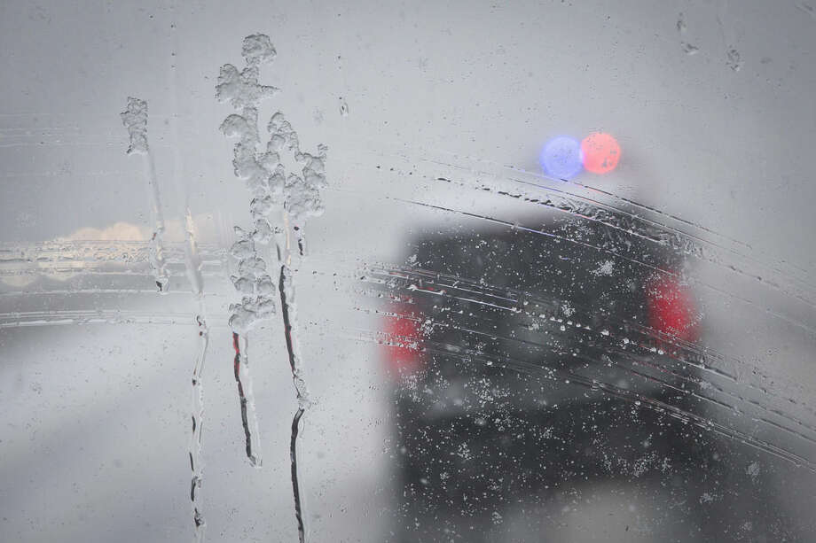 The motorcade of Democratic presidential candidate Sen. Bernie Sanders, I-Vt., drives through a snow storm on Interstate 93, Friday, Feb. 5, 2016, in Manchester, N.H. What started off as rain Friday morning quickly turned to sticky, heavy snow. Many school districts in the region closed for the day, including in some in Massachusetts, New Hampshire and Rhode Island. (AP Photo/John Minchillo)