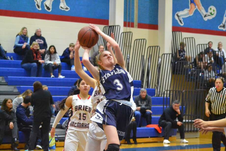 Staples' girls basketball game vs. Ridegfield is one of the games that has been cancelled due to the storm. (Hour file photo/Pete Paguaga)