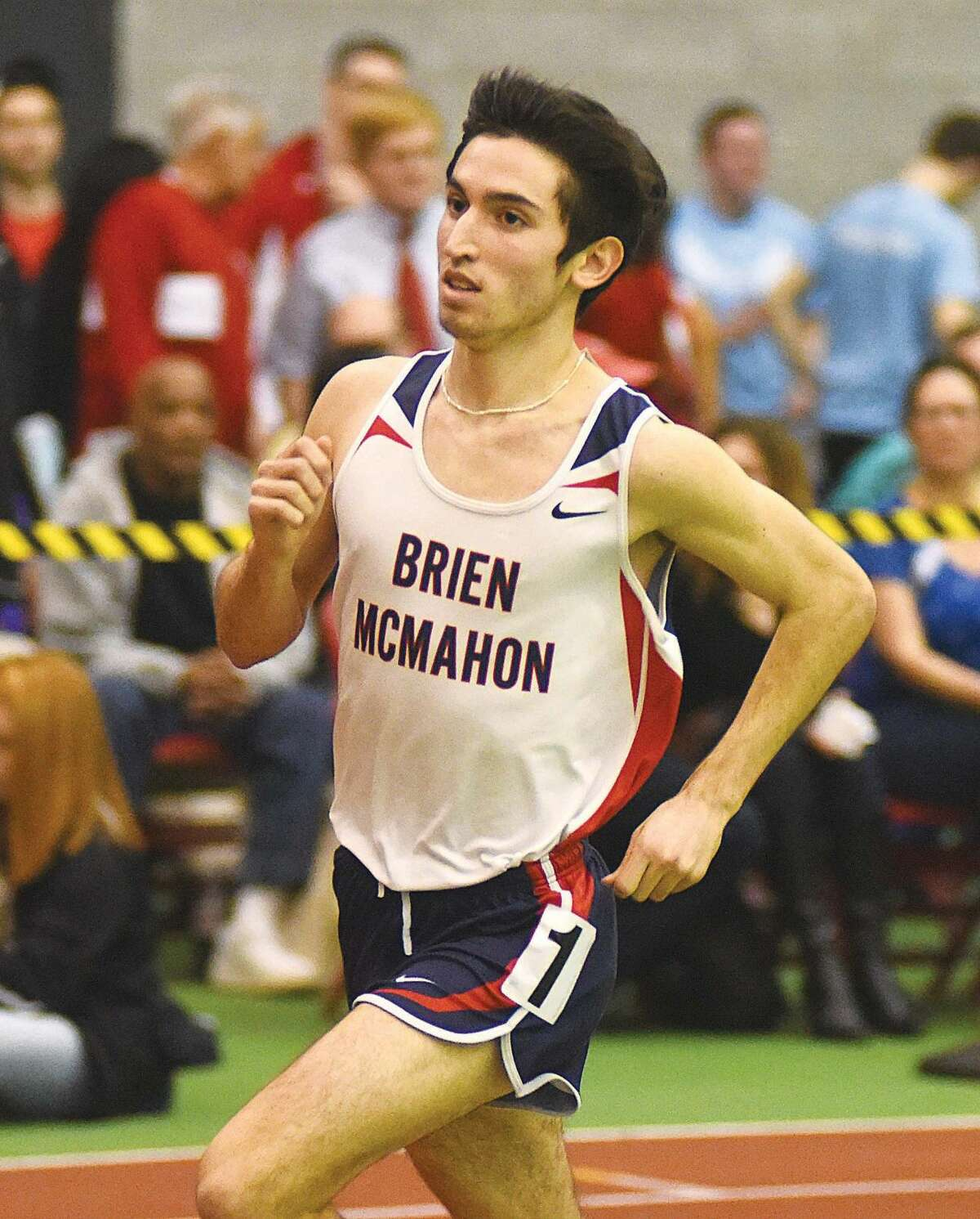 Hour photo/John Nash - Brien McMahon's Eric van der Els races during the boys 1,600 meter run during Thursday's FCIAC indoor track championship meet at the Floyd Little Athletic Center in New Haven.