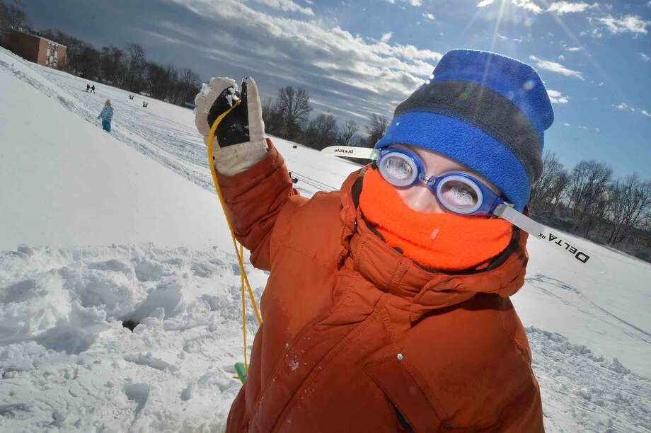 Hour Photo/Alex von Kleydorff At West Rocks School, 6yr old Matthew Maiman all bundled up pulls his sled up the hill while enjouying a snow day from school