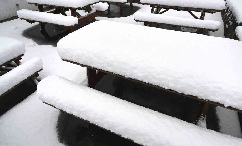 Hour Photo/Alex von Kleydorff Tables covered in snow at Mr Frosty's on Friday