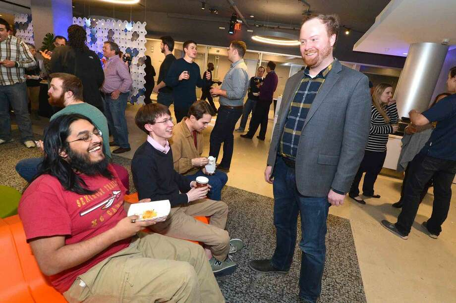 Hour Photo/Alex von Kleydorff DATTO Founder and CEO Austin McChord enjoys the company of his co-workers during a party to celebrate the companies new space connected by a grand staircase at 101 Merritt 7