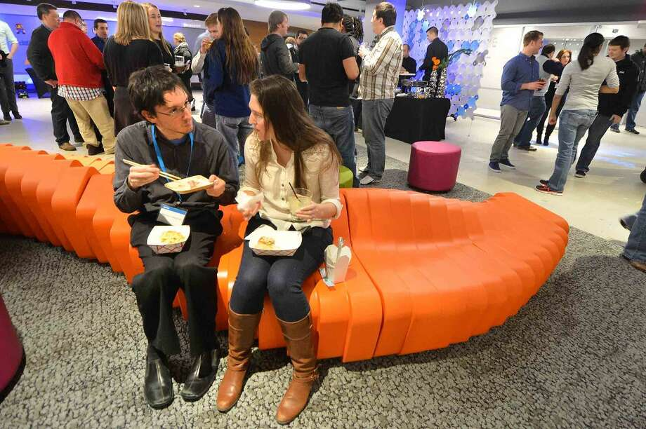 Hour Photo/Alex von Kleydorff Alfonso Costagliola and Kristen Rydberg enjoy some sushi and signature cocktails at a party to celebrate DATTO's new space connected by a grand staircase at 101 Merritt 7