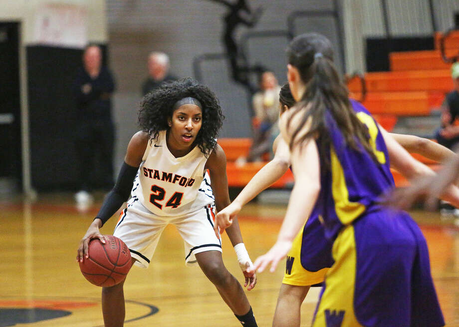 Stamford's No. 24, Samantha Johas-Folkes, dribbles the ball during a game against Westhill at Stamford High School Monday evening.